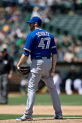 OAKLAND, CA - JULY 23:  Bo Schultz #47 of the Toronto Blue Jays stands on the pitchers mound against the Oakland Athletics during the ninth inning at O.co Coliseum on July 23, 2015 in Oakland, California. The Toronto Blue Jays defeated the Oakland Athletics 5-2. (Photo by Jason O. Watson/Getty Images) *** Local Caption *** Bo Schultz
