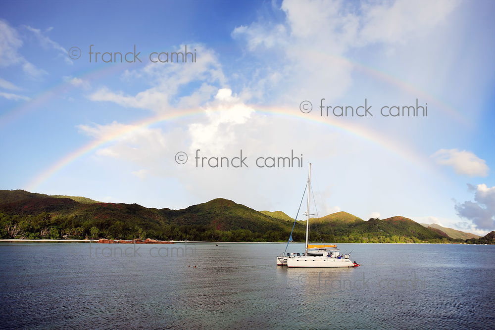 two natural not photoshoped rainbows over saint anne bay at praslin one of the seychelles island