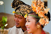Apr. 22 - UBUD, BALI, INDONESIA:   The groom and bride during a wedding in a home in Ubud, Bali, Indonesia. Weddings in Bali have three parts, the first is the ceremony where the couple is wedded. Then the wedding party goes to the bride's family home so the bride can say goodbye to her family. Then there is a wedding reception which is quite similar to western wedding receptions.  Photo by Jack Kurtz/ZUMA Press.