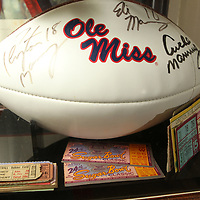 An autgraphed football by the Manning family is enclosed along with Chuck's parents Sugar Bowl tickets where Ole Miss played 58 years ago.