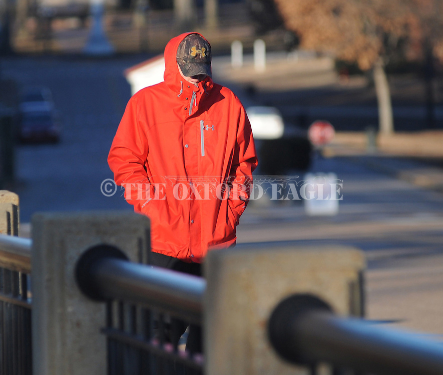 John Jenks is bundled up for cold weather as he walks along University Avenue in Oxford, Miss. on Thursday, January 8, 2015. Dangerously cold air has sent temperatures plummeting into the single digits around the U.S., with wind chills driving them even lower. (AP Photo/Oxford Eagle, Bruce Newman)