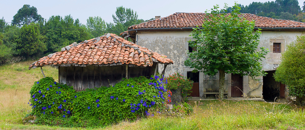 Traditional home with raised hay barn near Valle de Valdeon in Picos de Europa, Northern Spain