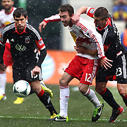 Eric Alexander, New York Red Bulls, is challenged by Perry Kitchen, D.C. United, (right), in action during the New York Red Bulls V D.C. United, Major League Soccer regular season match at Red Bull Arena, Harrison, New Jersey. USA. 16th March 2013. Photo Tim Clayton