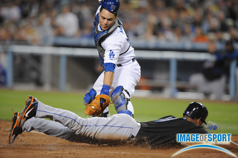 May 6, 2008; Los Angeles, CA, USA; New York Mets left fielder Moises Alou (18) slides beneath the tag of Los Angeles Dodgers catcher Russell Martin (55) to score in the third inning at Dodger Stadium.