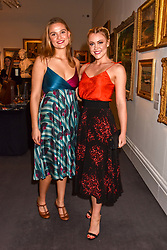 Phoebe Flockhart and Camilla Kerslake at the Women for Women International #SheInspiresMe Auction held at Sotheby's New Bond Street, England. 19 November 2018. <br /> <br /> ***For fees please contact us prior to publication***