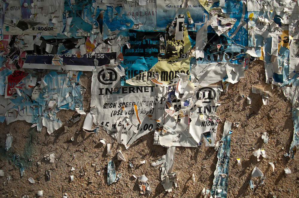 colorful fragments of an aged bulletin board found in Greece