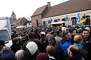 Belgium, March 31 2013: The square in Kwaremont was full of spectators who were able to eat, drink and watch the Ronde van Vlaandaren 2013 both on the Oude-Kwaremont climb and then on the large tv screens. Copyright 2013 Peter Horrell.