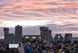 © Licensed to London News Pictures.21/06/2016. Stonehenge, Amesbury, Wiltshire, UK. Summer Solstice celebrations at Stonehenge. This year is a leap year and so the actual Solstice fell on 20 June. There was also a 'Strawberry' full moon to coincide with the Solstice, the first time for decades. Photo credit : Simon Chapman/LNP