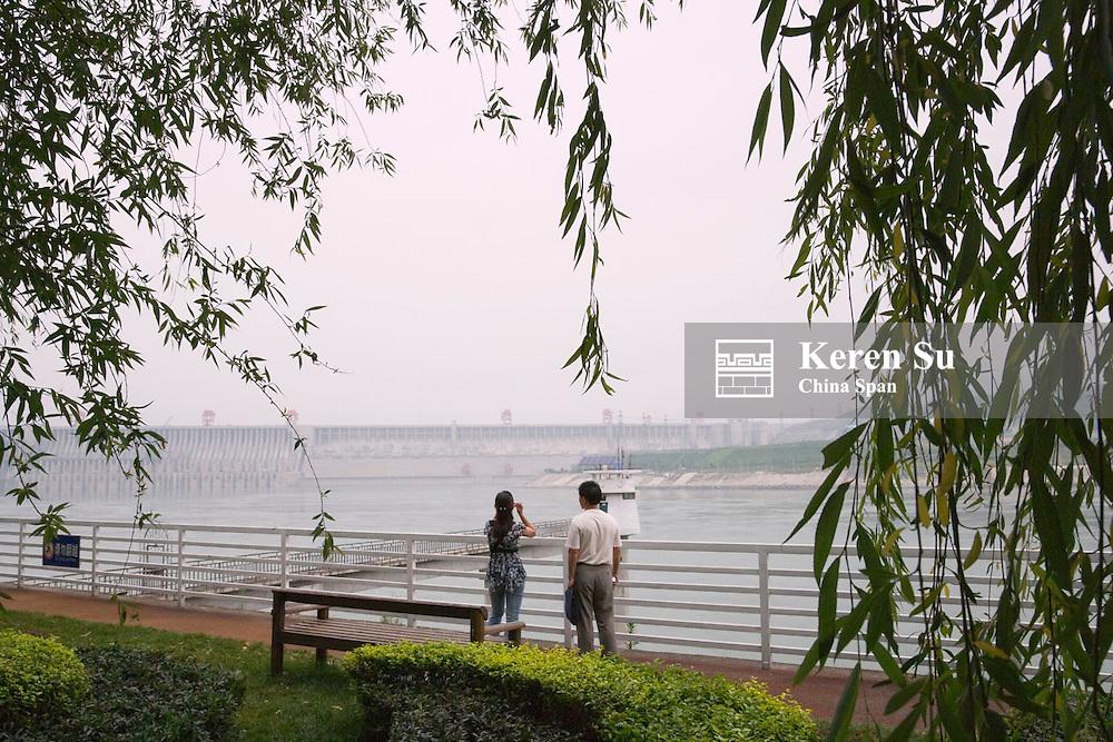 Tourists watch Three Gorges Dam construction site, Zigui, Hubei, China