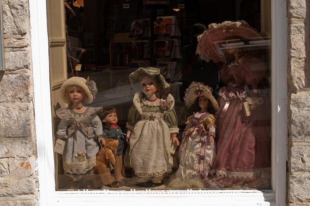 Antique dolls in store window in Virginia City, Montana