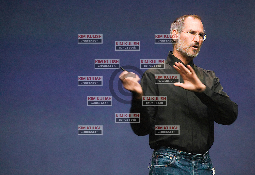 Apple Computer CEO Steve Jobs gestures at an Apple event in San Francisco, Tuesday, Sept. 12, 2006. Apple Computer launched its long-awaited online movie service Tuesday with minimal participation from Hollywood and showed off a device that will make it easier for consumers to watch the videos on television.  Photo by Kim Kulish