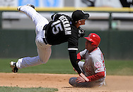 CHICAGO - APRIL 17:  Gordon Beckham #15 of the Chicago White Sox turns a double play over the sliding Peter Bourjos #25 Los Angeles Angels in the fifth inning on April 17, 2011 at U.S. Cellular Field in Chicago, Illinois.  The Angels defeated the White Sox 4-2.  (Photo by Ron Vesely)  Subject:  Gordon Beckham;Peter Bourjos
