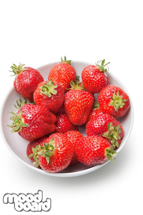 Bowl full of strawberries against white background