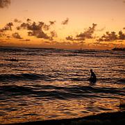 Waikiki Beach at sunset is one of the most famous beaches in the world. The two mile stretch of white sand coast is fronted by hotels and tourist facilities. <br />
