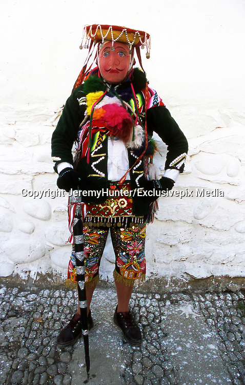 Amazing costumes of the Pagan-Christian festival <br /> <br /> In Peru, every July,  Paucartambo, a remote white-washed town, nestling at 10,000 feet up in the Andes, hosts one of the biggest festivals in South America.<br /> <br /> This Pagan-Christian festival celebrates The Earth Mother, Patron Saint of the Mestizo, a half-caste group - part European, part AmerIndian -  who reached Paucartamo during the 17th century.<br /> <br /> For three days, The Earth Mother is carried around the town, protected by rival mythical birds and animals who scale the roof-tops enacting a story of  struggles and miracles.<br /> Many of these wear feathered head-dresses for during the 17th century feathers were considered more valuable than gold. it&rsquo;s a wild, noisy and drunken celebration!<br /> <br /> Mythical birds and animals enact a story of struggles and miracles<br /> Paucartambo Festival, Peru<br /> &copy;JeremyHunter/Exclusivepix Media