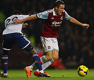 Picture by David Horn/Focus Images Ltd +44 7545 970036<br /> 23/11/2013<br /> Stewart Downing of West Ham United (right) escapes a challenge from Samuel Eto'o of Chelsea during the Barclays Premier League match at the Boleyn Ground, London.