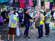 07 NOVEMBER 2017 - BANGKOK, THAILAND: Selling sweaters at a local market on Ekkamai Soi 30 in Bangkok.      PHOTO BY JACK KURTZ