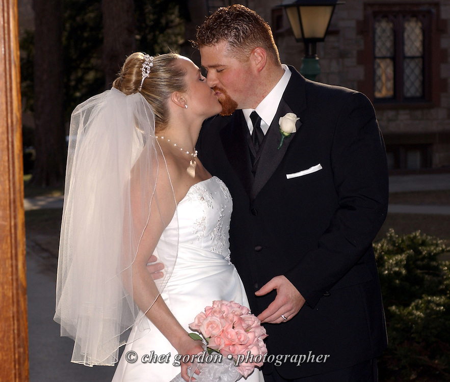 "Newlyweds Alison Anne Reitter and Michael Orlando kissing in the doorway of The University Church on the campus of Fordham University in the Bronx, NY after their wedding ceremony on Saturday, March 15, 2003.  Quote from the Best Man, Christopher Orlando: "" Michael and Alison are soulmates, not one created on TV or made over a couple of weeks. Their relationship is built to last."" (Photograph by Chet Gordon for The New York Daily News)"