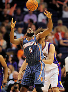 Feb. 4, 2012; Phoenix, AZ, USA; Charlotte Bobcats forward D.J. White reaches for the ball against the Phoenix Suns center Robin Lopez (15) during the first half at the US Airways Center.  The Suns defeated the Bobcats 95 - 89. Mandatory Credit: Jennifer Stewart-US PRESSWIRE.