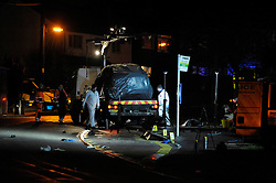 © Licensed to London News Pictures. File pic dated 27/01/2013. Bristol, UK. Forensics examine A car covered by a sheet on a recovery vehicle at the scene where Ross and Clare Simons  were killed when the tandem bike they were riding was hit by a car. Nicholas Lovell, who was driving the car that knocked them off their tandem bike today admitted two counts of causing death by dangerous driving. Photo credit : Simon Chapman/LNP
