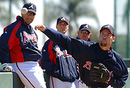 Atlanta Braves coach Eddie Perez, left to right, pitcher Tim Hudson, and coach Joe Breeden watch as John Smoltz pitches in the bullpen during Spring Training baseball practice in Lake Buena Vista, Florida.