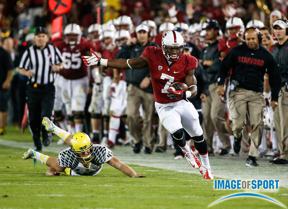 Nov. 7, 2013; Stanford, CA, USA; Stanford Cardinal wide receiver Ty Montgomery (7) returns opening kickoff 57 yards in the second half against the Oregon Ducks at Stanford Stadium. Stanford defeated Oregon 26-20.