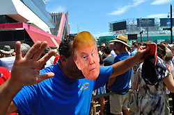 A Trump supporter wears a mask as he attends a July 7th, 2016 campaign stop of Hillary Clinton at the closed Trump Plaza Casino on the Boardwalk in Atlantic City, New Jersey.