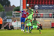 Forest Green Rovers Kaiyne Woolery(14) goes up for a header with Dagenham's Paul Benson(14) during the Vanarama National League first leg play off match between Dagenham and Redbridge and Forest Green Rovers at the London Borough of Barking and Dagenham Stadium, London, England on 4 May 2017. Photo by Shane Healey.