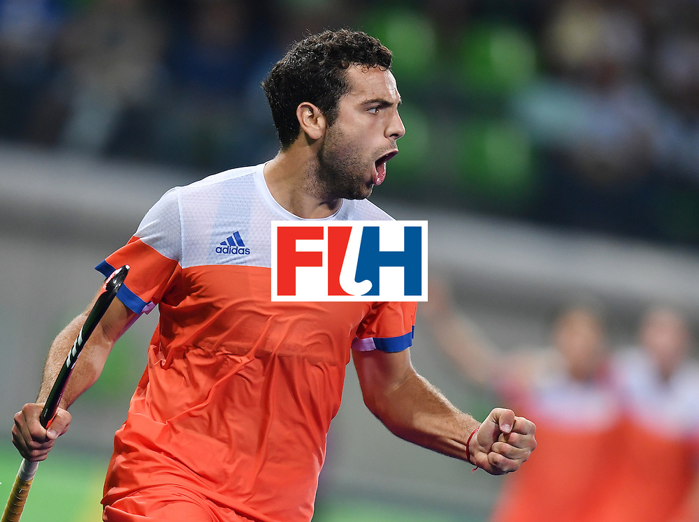 Netherland's Valentin Verga celebrates his team's third goal during the men's quarterfinal field hockey Netherlands vs Australia match of the Rio 2016 Olympics Games at the Olympic Hockey Centre in Rio de Janeiro on August 14, 2016. / AFP / MANAN VATSYAYANA        (Photo credit should read MANAN VATSYAYANA/AFP/Getty Images)