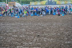 The rubbish is trampled into the mud but an army of voulunteers has already cleared a large area in the now empty Other Stage crowd area - the festival motto is 'Leave no trace'.The 2015 Glastonbury Festival, Worthy Farm, Glastonbury.