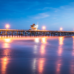 San Clemente California pier at sunset panorama photo. San Clemente is a popular beach city in Orange County in the United States of America. Panorama photo ratio is 1:3. Copyright ⓒ 2017 Paul Velgos with all rights reserved.