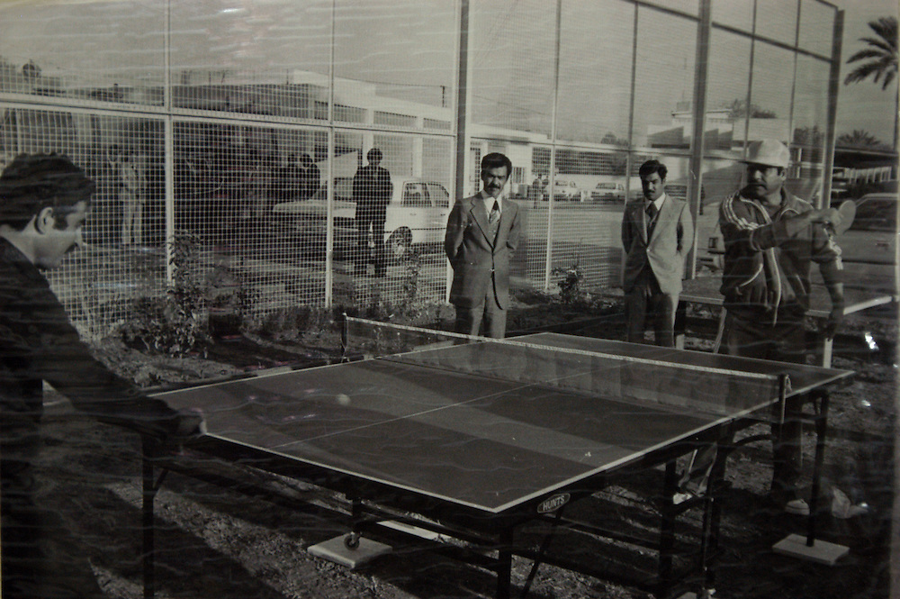 A family photo of Saddam Hussein playing ping-pong with his son-in-law, Saddam Kemal. Kemal and his brother Hussein, another son-in-law were killed by Saddam along with 15 members of their family when the brothers returned to Iraq after fleeing to Jordan. .Baghdad, Iraq. 30 May 2003..Photo © J.B. Russell