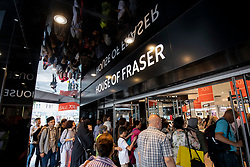 © Licensed to London News Pictures. 10/08/2018. London, UK. Shoppers enter House of Fraser's flagship store on Oxford Street in London as it opens. The department store chain has reportedly been bought by Sports Direct for £90m after administrators were appointed. Photo credit: Rob Pinney/LNP