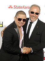 (CH) fl-el-billboard-latin-music-awards-CHa --Larry Hernandez, left, and Emilio Estefan arrive at the Billboard Latin Music Awards 2012 at Bank United Center on April 26, 2012 in Miami. Staff photo/Cristobal Herrera