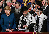 German Chancellor Angela Merkel (L) receives the 2013 Lord Jakobovits Prize for European Jewry from the President of the Conference of European Rabbis, Pinchas Goldschmidt (C) and Rabbi Guigui (R)  at the Great Synagogue of Europe in Brussels, Belgium, 22 May 2013. The Award is named in honour and memory of Lord Immanuel Jakobovits, a former President of the Conference of European Rabbis and Chief Rabbi of the United Hebrew Congregations of the Commonwealth. Lord Jakobovits dedicated his life to the pursuit of a philosophy which advocated religious commitment with unyielding love and consideration for his fellow man. Merkel was awarded the Jakobovits prize to mark her strong record of support for the German Jewish Community and her outspoken denunciation of anti-Semitism throughout Europe.