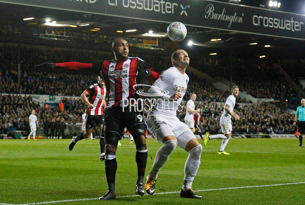 Pierre-Michel Lasogga of Leeds United and Sheffield United's striker Leon Clarke contest a loose ball during the EFL Sky Bet Championship match between Leeds United and Sheffield Utd at Elland Road, Leeds, England on 27 October 2017. Photo by Paul Thompson.