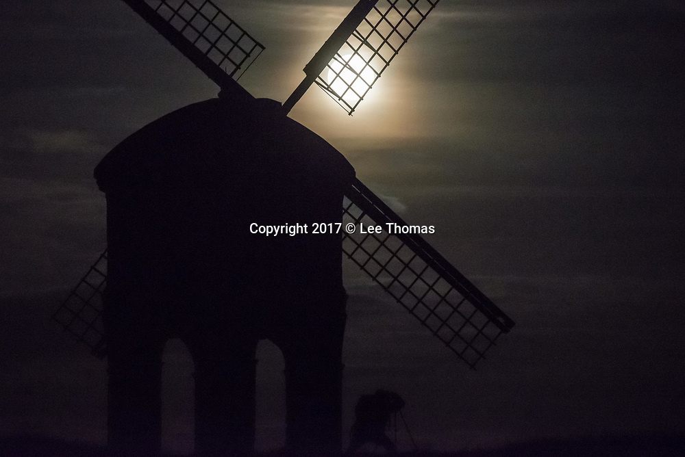 "Chesterton, Warwickshire, UK. 3rd December 2017. The so called ""Cold"" supermoon rises above the eastern horizon at Chesterton. The Warwickshire village is home to the striking Grade 1 listed Chesterton Windmill, built in 1632 from a design attributed to Inigo Jones, just off the Fosse Way. Pictured: A photographer takes a shot of the moon. // Lee Thomas, Tel. 07784142973. Email: leepthomas@gmail.com  www.leept.co.uk (0000635435)"