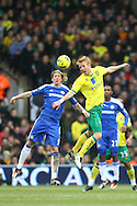 Picture by Paul Chesterton/Focus Images Ltd.  07904 640267.21/01/12.Zac Whitbread of Norwich and Fernando Torres of Chelsea in action during the Barclays Premier League match at Carrow Road Stadium, Norwich.