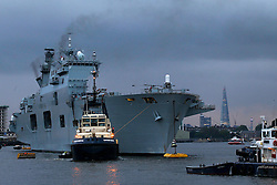 © Licensed to London News Pictures. 13/07/2012, London, UK.  Helicopters carrier, HMS Ocean arrives at Greenwich in London to provide security for the upcoming London 2012 Olympic Games, Friday, July 13, 2012. Photo credit : Sang Tan/LNP