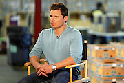 CINCINNATI, OH - OCTOBER 5:  Nick Lachey conducts a television interview during the kickoff to The Everybody Wins Tour at Freestore Foodbank on October 5, 2009 in Cincinnati, Ohio. (Photo by Joe Robbins/WireImage for Foodbank)