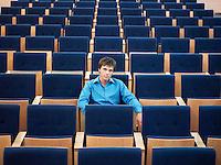 Businessman sitting alone in Auditorium portrait