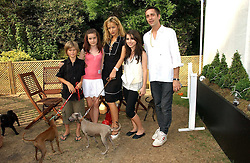 JADE JAGGER with her daughters ASSISI and AMBA, DAN WILLIAMS and his son TAI WILLIAMS with their dogs at the Macmillan Cancer Support Dog Day held in the gardens of the Royal Hospital, Chelsea, London on 4th July 2006.<br />