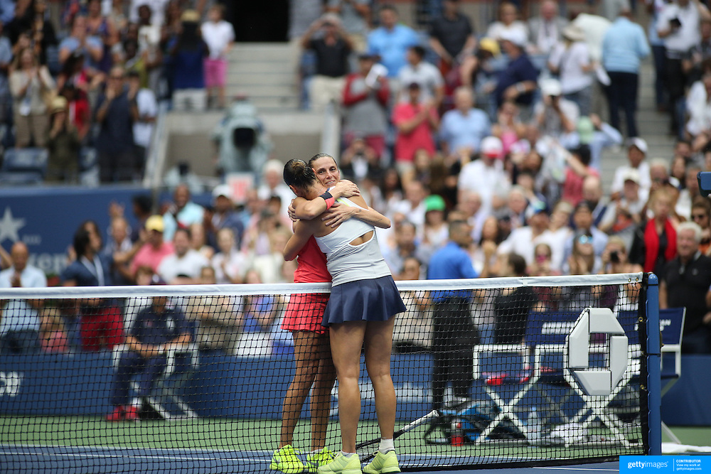Flavia Pennetta, Italy, is embraced at the net by Roberta Vinci Italy, after winning Women's Singles Final match during the US Open Tennis Tournament, Flushing, New York, USA. 12th September 2015. Photo Tim Clayton
