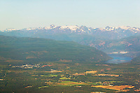 An aerial view of the city of Cumberland and its proximity to Comox Lake and the Comox Glacier, collectively known as the Comox Valley.  Cumberland, Vancouver Island, British Columbia, Canada.