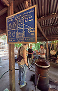 Laos. Ban Xang Hai at the Mekong. Traditional Whiskey Lao making.