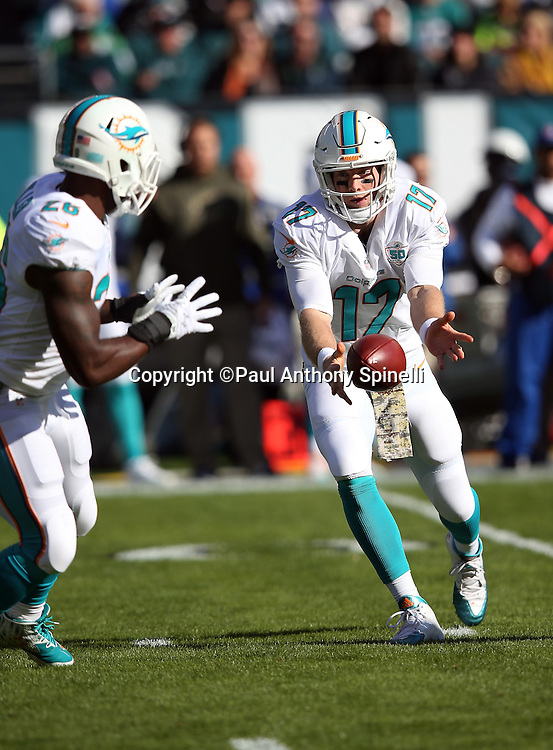 Miami Dolphins quarterback Ryan Tannehill (17) pitches the ball to Miami Dolphins running back Lamar Miller (26) during the 2015 week 10 regular season NFL football game against the Philadelphia Eagles on Sunday, Nov. 15, 2015 in Philadelphia. The Dolphins won the game 20-19. (©Paul Anthony Spinelli)