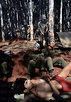 Captured Vietcong soldiers under the guard of South Vietnamese soldiers.April 1975. Photograph by Terry Fincher