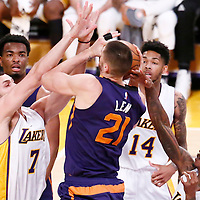 06 November 2016: Phoenix Suns center Alex Len (21) is fouled by Los Angeles Lakers guard Louis Williams (23) facing Los Angeles Lakers forward Larry Nance Jr. (7) during the LA Lakers 119-108 victory over the Phoenix Suns, at the Staples Center, Los Angeles, California, USA.