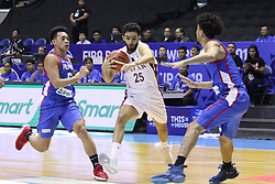 September 17, 2018 - Quezon City, NCR, Philippines - Khaled Mohamed Abdelbaset (White) of Qatar gets double teamed by Scottie Thompson (6, Blue) and Gabe Norwood (5, Blue) of the Philippines. (Credit Image: © Dennis Jerome S. Acosta/Pacific Press via ZUMA Wire)