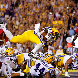 November 3, 2012; Baton Rouge, LA, USA;  LSU Tigers running back Jeremy Hill (33) leaps past Alabama Crimson Tide linebacker Nico Johnson (35) over the goal line to score during a game at Tiger Stadium. Alabama defeated LSU 21-17. Mandatory Credit: Derick E. Hingle-US PRESSWIRE